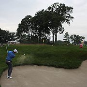 Rory McIlroy chips out of the bunker on the second hole during the ProAm at The Barclays Golf Tournament at The Ridgewood Country Club, Paramus, New Jersey, USA. USA. 20th August 2014. Photo Tim Clayton