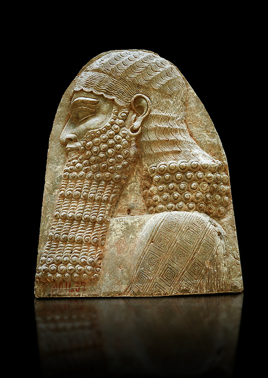 Stone relief sculptured panel fragment of a Dignitary. Inv AO 1432 from Dur Sharrukin the palace of Assyrian king Sargon II at Khorsabad, 713-706 BC.  Louvre Museum Room 4 , Paris .<br /> <br /> If you prefer to buy from our ALAMY PHOTO LIBRARY  Collection visit : https://www.alamy.com/portfolio/paul-williams-funkystock/ancient-assyria-antiquities.html  Refine search by adding background colour, place, subject, museum etc into the LOWER SEARCH WITHIN GALLERY box to <br /> <br /> Visit our ANCIENT ASSYRIAN PHOTO COLLECTIONS for more photos to download or buy as wall art prints https://funkystock.photoshelter.com/gallery-collection/Ancient-Assyrian-Art-Artefacts-Antiquities-Historic-Sites-Pictures-Images-of/C0000cjRqQyJjLag