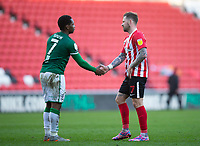 Football - 2020 / 2021 Sky Bet League One - Sunderland vs Lincoln City - Stadium of Light<br /> <br /> Chris Maguire of Sunderland and Tayo Edun of Lincoln City at full time<br /> <br /> Credit: COLORSPORT/BRUCE WHITE
