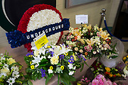 London, UK. Tuesday 7th July 2015. 10th anniversary of the London 7/7 bombings. Flowers are laid in memory of the victims of the terrorist attack in London. Here the memorial in Russell Square underground station, where the 3rd tube bombing took place. People gather in memorial by the memorial flowers. The 7 July 2005 London bombings (often referred to as 7/7) were a series of coordinated suicide bomb attacks in central London, which targeted civilians using the public transport system during the morning rush hour.