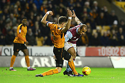 Gabriel Agbonlahor of Aston Villa is tackled by Danny Batth of Wolverhampton Wanderers - Mandatory by-line: Dougie Allward/JMP - 14/01/2017 - FOOTBALL - Molineux - Wolverhampton, England - Wolverhampton Wanderers v Aston Villa - Sky Bet Championship
