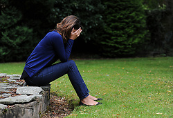 PICTURE POSED BY MODEL. A woman showing signs of depression.