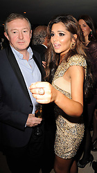 CHERYL COLE and LOUIS WALSH at the launch party for 'Promise', a new capsule ring collection created by Cheryl Cole and de Grisogono held at Nobu, Park Lane, London on 29th September 2010.