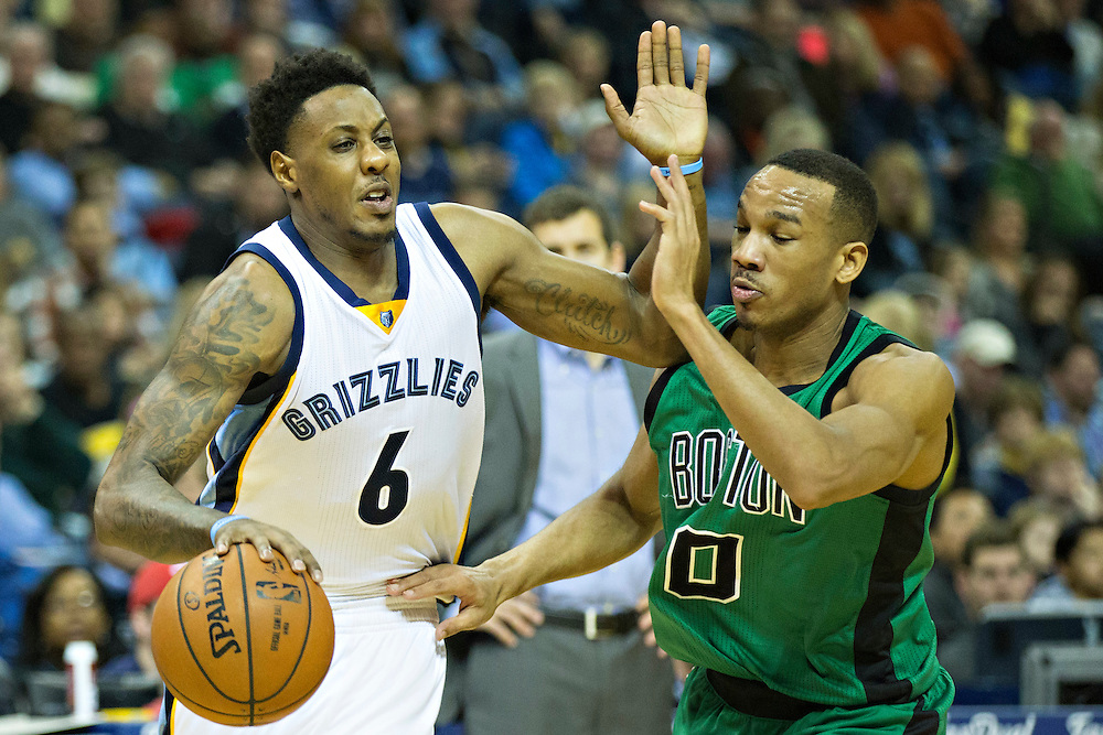 """MEMPHIS, TN - JANUARY 10:  Mario Chalmers #6 of the Memphis Grizzlies drives to the basket while being defended by Avery Bradley #0 of the Boston Celtics at FedExForum on January 10, 2016 in Memphis, Tennessee.  """"NOTE TO USER: User expressly acknowledges and agrees that, by downloading and or using this photograph, User is consenting to the terms and conditions of the Getty Images License Agreement.""""  (Photo by Wesley Hitt/Getty Images) *** Local Caption *** Mario Chalmers; Avery Bradley"""