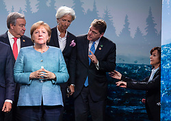 Secretary-General of the United Nations Antonio Guterres, left, Chancellor of Germany Angela Merkel, Managing Director of the IMF Christine Lagarde and U.S. G7 Sherpa Everett Eissenstat look on as an organizer tries to direct the group along the stage during a family photo with representatives from G7 leaders, outreach countries and international organizations at the G7 leaders summit in La Malbaie, Quebec on June 9, 2018. Photo by Justin Tang/CP/ABACAPRESS.COM
