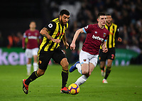 Football - 2018 / 2019 Premier League - West Ham United vs. Watford <br /> <br /> Watford's Troy Deeney holds off the challenge from West Ham United's Declan Rice, at The London Stadium.<br /> <br /> COLORSPORT/ASHLEY WESTERN