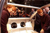 28 JAN 2004, BERLIN/GERMANY:<br /> Edelgard Bulmahn, SPD, Bundesforschungsministerin, besichtigt ein halbes Auto, welches innovative Leichtbauweise neuer Stahlkonstruktionen zeigt, Eroeffnungsveranstaltung Jahr der Technik, Deutsches Technik Museum<br /> IMAGE: 20040128-01-010