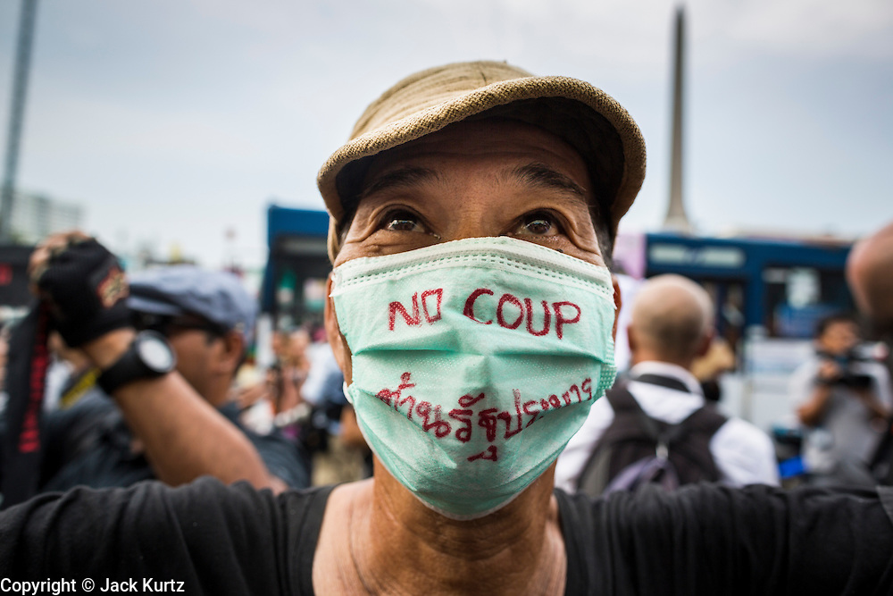 26 MAY 2014 - BANGKOK, THAILAND:  A man protests against the coup in Thailand at Victory Monument during a pro-democracy rally in Bangkok. About two thousand people protested against the coup in Bangkok. It was the third straight day of large pro-democracy rallies in the Thai capital as the army continued to tighten its grip on Thai life.  PHOTO BY JACK KURTZ