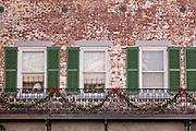 Christmas decorations along the ironwork balcony at The Marshall House Savannah, GA.
