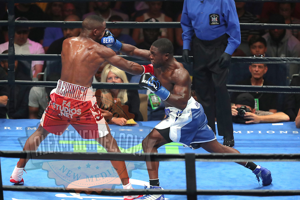 Andre Berto lands a straight right to the face of Devon Alexander during a Premier Boxing Champions fight on Saturday, August 4, 2018 at the Nassau Veterans Memorial Coliseum in Uniondale, New York.  (Alex Menendez via AP)