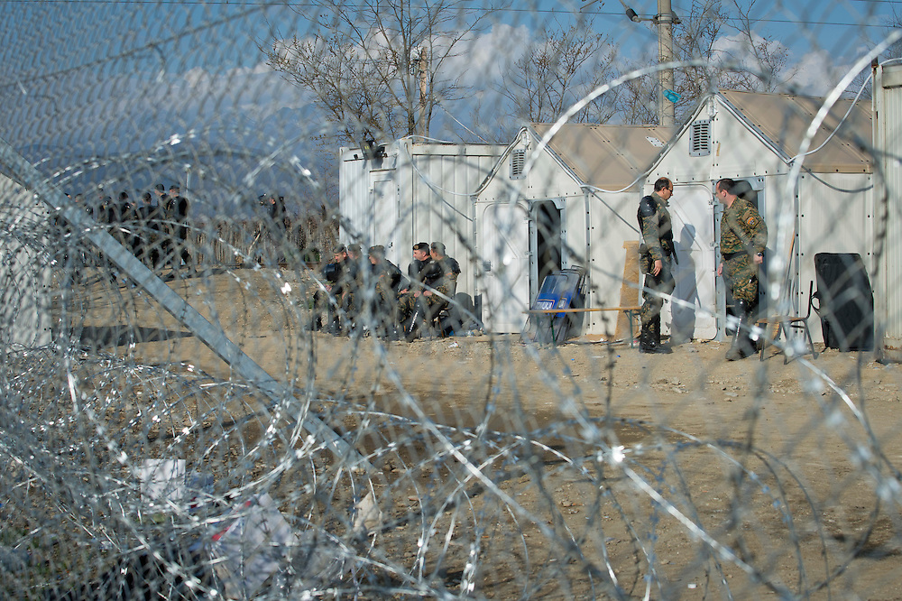 March 3, 2016, Idomeni, Greece. Macedonian military guard the border at the Idomeni border crossing. 12.000 refugees are stuck here after Macedonia closed the border.  New arrivals come in every day, making living conditions difficult.(Steven Wassenaar/Polaris)