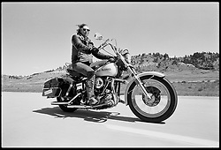 Moto Madonna on I-90. SD, 1986<br /> <br /> Limited Edition Print from an edition of 20. Photo ©1981 Michael Lichter.