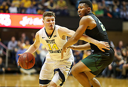 Jan 9, 2018; Morgantown, WV, USA; West Virginia Mountaineers guard Chase Harler (14) drives towards the basket during the second half against the Baylor Bears at WVU Coliseum. Mandatory Credit: Ben Queen-USA TODAY Sports