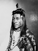 Half-length portrait of male Indian in native dress, 1899.