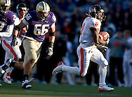 Oregon State's James Rodgers runs in for a touchdown on a pass play with Washington's Daniel Te'o-Nesheim (66) chasing during the second quarter of an NCAA college football game in Seattle. (AP Photo/John Froschauer)