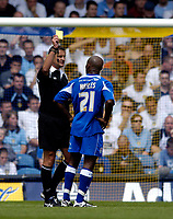 Fotball<br /> Foto: SBI/Digitalsport<br /> NORWAY ONLY<br /> <br /> Leeds United v Millwall<br /> Coca Cola Championship.<br /> 07/08/2005.<br /> <br /> Millwall's Barry Hayles is shown the yellow card by referee G Law for dissent in the wake of new directives by the FA for referees to clamp down on foul language
