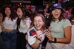 © Licensed to London News Pictures. 07/07/2021. London, UK. Supporters react to England's 2-1 victory over  Denmark in the EURO 2020 semi-final at Boxpark in Croydon, south London. Photo credit: Peter Macdiarmid/LNP