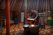 Batjatjral prepares fermented mare's milk, which is a staple part of the Mongolian nomadic diet. The surplus is sold, together with cheese, goatskins and sheepskins to supplement the family income.