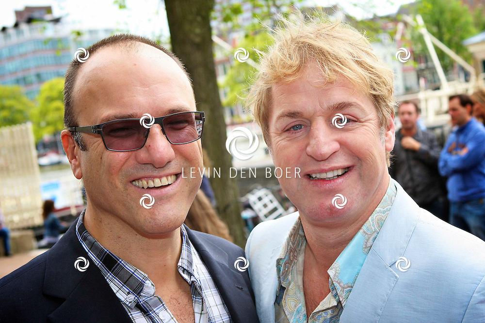 AMSTERDAM - Bij het Koninklijk Theater Carre is de premiere van Circus Hurricane Hans Klok van start gegaan.  Met op de foto Tony Neef met partner Benny. FOTO LEVIN DEN BOER - PERSFOTO.NU