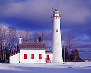 Winter view of Sturgeon Point Lighthouse built in 1869, Sturgeon Point State Park, Lake Huron, Michigan.