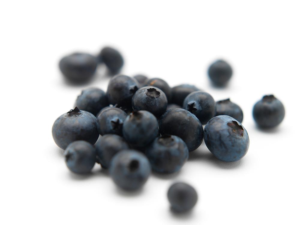 Mound of fresh raw blueberries on a white background