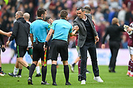 Hibernian FC manager, Jack Ross acknowledges the officials after the final whistle of the Cinch SPFL Premiership match between Heart of Midlothian and Hibernian at Tynecastle Park, Edinburgh, Scotland on 12 September 2021.
