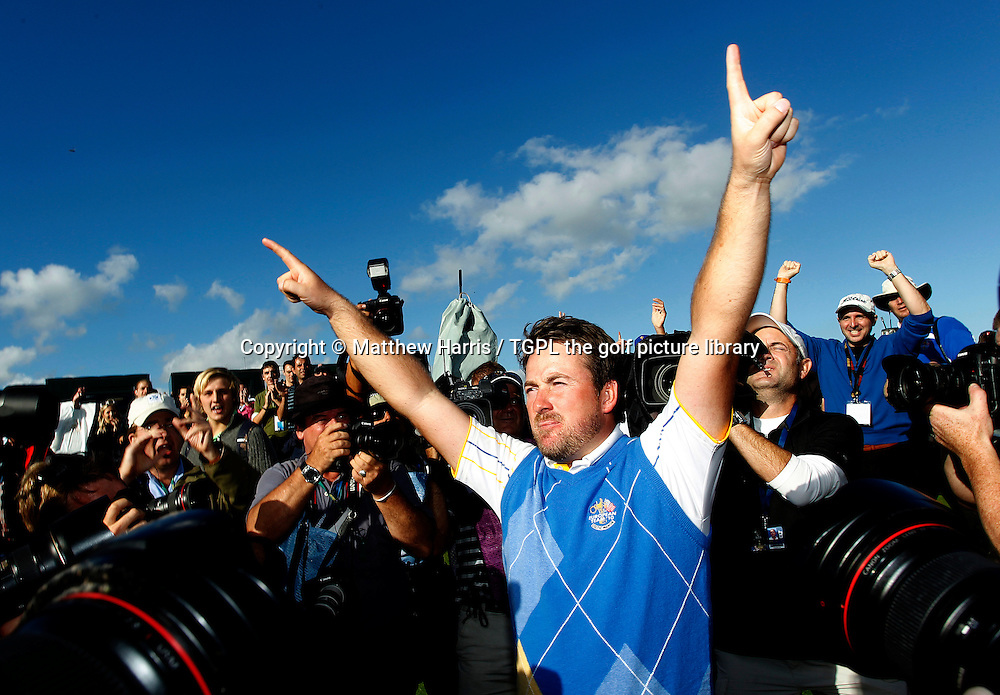 Arms aloft Graeme MCDOWELL (EUR) Europe's hero and the man who won the winning point celebrates with fans and is surrounded by cameras from TV and Stills during Session_Four_Singles,Ryder Cup Matches,Celtic Manor Twenty Ten Course,Newport,Gwent,Wales.