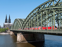 Hohenzollern Bridge crossing the River Rhine with Dom or Cathedral to rear in Cologne Germany