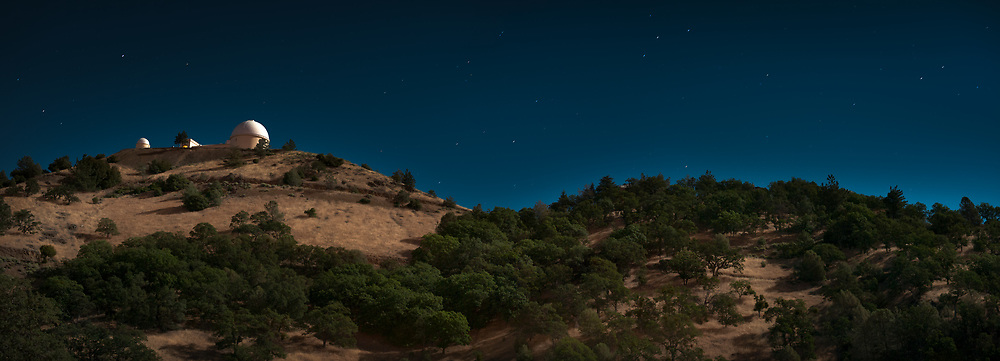 Lick Observatory is seen on a moonlit night atop the summit of Mount Hamilton. from Mt. Hamilton road below. Diablo Range. Santa Clara County, CA.