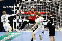 Stas Skube of Slovenia vs Andreas Wolff of Germany during handball match between National Teams of Germany and Slovenia at Day 2 of IHF Men's Tokyo Olympic  Qualification tournament, on March 13, 2021 in Max-Schmeling-Halle, Berlin, Germany. Photo by Vid Ponikvar / Sportida