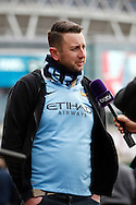 A Manchester City fan is interviewed outside the stadium prior to kick off. Capital One Cup Final, Liverpool v Manchester City at Wembley stadium in London, England on Sunday 28th Feb 2016. pic by Chris Stading, Andrew Orchard sports photography.