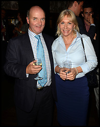 Nadine Dorries with Sunday Express columnist Adam Helliker attend The InterContinental Westminster  Political Party. London, United Kingdom. Wednesday, 11th September 2013. Picture by Andrew Parsons / i-Images