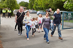 © Licensed to London News Pictures. 25/05/2015. DIDCOT, UK. Parents and children leave All Saints Primary School, where 6 year old Derrin Jordon attended. Police found three bodies, including her's, in Vicarage Road, Didcot, on Saturday evening and  continue to search for Jed Allen in connection with the deaths. Photo credit : Cliff Hide/LNP