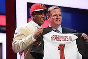 28 April 2016: Florida's Vernon Hargreaves III walks on stage and poses with NFL Commissioner Roger Goodell and his jersey after being drafted as 11th Pick by the Tampa Bay Buccaneers in the first round of the 2016 NFL Draft, held at the Auditorium Theatre, in Chicago IL.  (Photo By Robin Alam/Icon Sportswire)