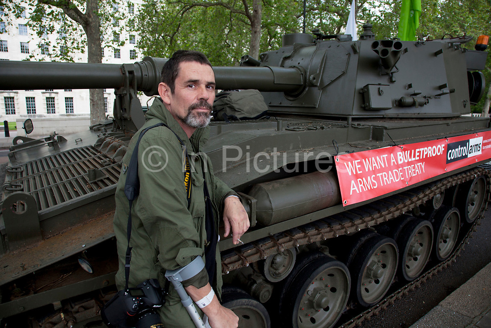 Injured war photographer Paul Conway lends his support to the campaign.Campaigners and supporters from Oxfam and Amnesty International, as part of the Control Arms coalition, drive an Abbot gun tank around central London to highlight the need for a global Arms Trade Treaty (ATT) to be agreed during a United Nations conference next month (July 2012). London, England, UK. 27th June 2012.