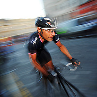 Some of the UK's top pro cyclists race through the streets in Edinburgh's Grassmarket area during the 2009 Edinburgh Nocturne Series cycling championships.  Pictured Rapha Condor rider Kristian House.