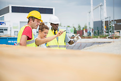 Architect with construction worker at building site, Munich, Bavaria, Germany