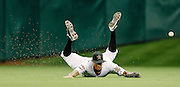 July 25, 2012; Houston, TX, USA; Houston Astros center fielder Justin Maxwell (44) dives for a fly ball against the Cincinnati Reds during the third inning at Minute Maid Park. Mandatory Credit: Thomas Campbell-US PRESSWIRE