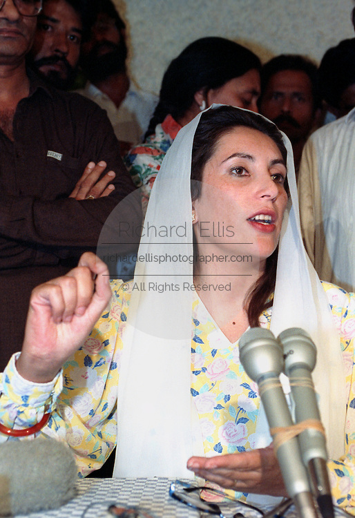 Prime Minister Benazir Bhutto and leader of the Pakistan People's Party speaks to the media on the eve of national elections from her home district October 24, 1990 in Larkana, Pakistan.