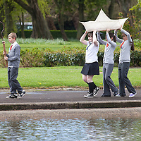 .IN PURSUIT OF THE QUESTION MARK.THE WORK OF GEORGE WYLLIE INSPIRES A NEW GENERATION ..Picture shows : School children from the nearby Riverside Primary School and St Saviours  ( School kids  l-r  - Reegan MacLeod, Elise Caldwell,  Charley Brown  and  Josephine Barns who are involved in the Friends of George Wyllie project , carrying two of his sculptures at Elder Park, Govan, Glasgow, mirroring plans for the wider project, as part of the year-long Whysman Festival. (www.whysman.co.uk) ..Picture Drew Farrell.Tel : 07721-735041..The BIG Little Paper Boat Project..Schools in the towns on all sides of the Clyde, will be invited to participate in this project, with the potential involvement of thousands of pupils at all stages and sectors of education across over 575 schools...Using new education resources inspired by Wyllie's art, and which focus on the outcomes and experiences of Curriculum for Excellence, pupils from Clydeside schools across all levels will have the opportunity to explore industrial change in their area and learn about skills once used there. ..Echoing the creation of Wyllies famous Paper Boat, the young people will create a flotilla of Origami Line paper boats. Activities inside The Big Little Paper Boat Shed will form a major part of a George Wyllie retrospective at The Mitchell, Glasgow from 3rd November 2012 - January 31 2013...He gave the world social sculptures to remember. The Straw Locomotive and The Paper Boat, to name but two. Now Glasgow-born artist George Wyllies creative legacy is set to inspire a new generation, thanks to a major award from the Year of Creative Scotland, 2012...Former Customs & Excise officer George Wyllie, now aged 90 and living in a care home for retired mariners in Greenock, always wanted to engage the wider world in his creative vision. ..Part of The Year of Creative Scotland 2012, In Pursuit of the Question Mark will send sparks flying across the west of Scotland as the art of George Wyllie inspires citizens of