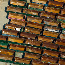 Aerial views of a rusted container cars used for transporting goods on trains.