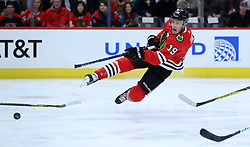 December 8, 2017 - Chicago, IL, USA - Chicago Blackhawks center Jonathan Toews (19) falls to the ice while taking a shot in the first period of a game against the Buffalo Sabres at the United Center Friday, Dec. 8, 2017 in Chicago. (Credit Image: © Chris Sweda/TNS via ZUMA Wire)