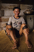 1989: Old Penan native, Sinan, wearing a Pepsi T-shirt. Long Napir, Limbang district, Sarawak, Borneo <br /> <br /> Tropical rainforest and one of the world's richest, oldest eco-systems, flora and fauna, under threat from development, logging and deforestation. Home to indigenous Dayak native tribal peoples, farming by slash and burn cultivation, fishing and hunting wild boar. Home to the Penan, traditional nomadic hunter-gatherers, of whom only one thousand survive, eating roots, and hunting wild animals with blowpipes. Animists, Christians, they still practice traditional medicine from herbs and plants. Native people have mounted protests and blockades against logging concessions, many have been arrested and imprisoned.