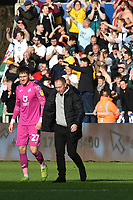 Football - 2019 / 2020 Sky Bet (EFL) Championship - Swansea City vs. Reading<br /> <br /> Freddie Woodman of Swansea City & Swansea Manager Steve Cooper  leave the pitch  after winning the South Wales derby match , at the Liberty Stadium.<br /> <br /> COLORSPORT/WINSTON BYNORTH
