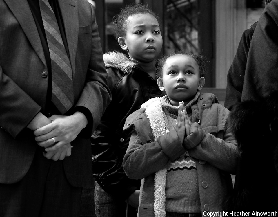 Children pray before participating in a march to memorialize the victims of last week's shooting that resulted in the deaths of 13 people in Binghamton, N.Y., Friday, April 10, 2009. (AP Photo/HEATHER AINSWORTH)