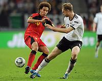 Fotball<br /> Tyskland v Belgia<br /> 11.10.2011<br /> Foto: Witters/Digitalsport<br /> NORWAY ONLY<br /> <br /> v.l. Axel Witsel, Per Mertesacker (Deutschland)<br /> Fussball, EM-Qualifikation, Deutschland - Belgien 3:1