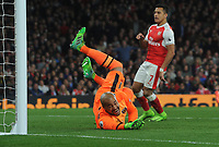 Football - 2016 / 2017 Premier League - Arsenal vs. West Ham United<br /> <br /> Mesut Ozil of Arsenal  scoring the opening goal past Darren Randolph at The Emirates.<br /> <br /> COLORSPORT/ANDREW COWIE