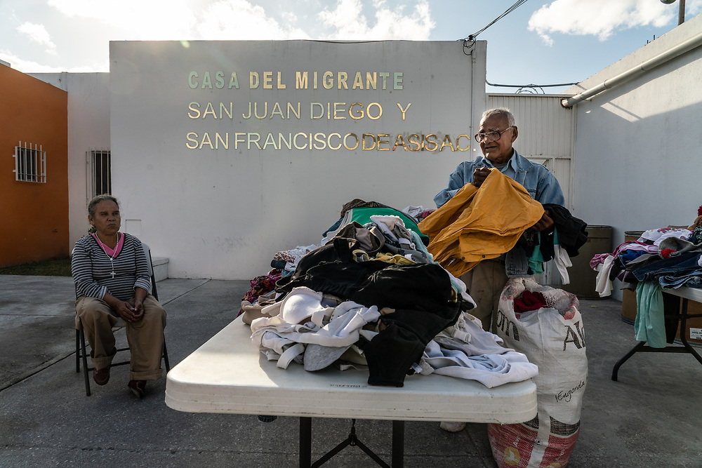 A volunteer folds donated clothing at Casa del Migrante, an organization managing the return of migrants back to Mexico after they've been deported January 24, 2019 in Matamoros, Mexico.