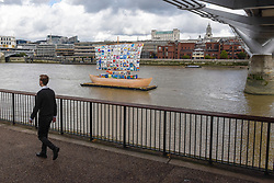 """© Licensed to London News Pictures. 04/09/2019. LONDON, UK. A man passes by during the launch of """"The Ship of Tolerance"""" at Tate Modern, Bankside.  The floating installation by Emilia Kabakov (of Russian conceptual artist duo Ilya and Emilia Kabakov) forms part of Totally Thames Festival and will be moored 4 September to 31 October.  The goal of the artwork is to educate and connect the youth of the world through the language of art.  Photo credit: Stephen Chung/LNP"""