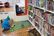 Young readers in the re-opened Carnegie Library on Herne Hill in south London which has opened its doors for the first time in almost 2 years, on 15th February 2018, in London, England. Closed by Lambeth council and occupied by protesters for 10 days in 2016, the library bequeathed by US philanthropist Andrew Carnegie has been locked ever since because, say Lambeth austerity cuts are necessary. A gym that locals say they don't want or need has been installed in the listed basement and actual library space a fraction as before and it's believed no qualified librarians will be present to administer it. Protesters also believe this community building will ultimately sold off by Lambeth council for luxury homes.